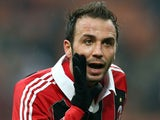 Milan's Giampaolo Pazzini celebrates after scoring the opening goal against Bologna on January 20, 2013