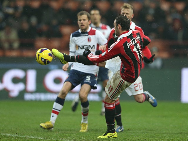 Milan's Giampaolo Pazzini scores his second goal in the match against Bologna on January 20, 2013