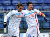 Catania's Gonzalo Bergessio is congratulated by team mate Mariano Julio Izco after scoring the opening goal against Genoa on January 20, 2013