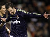 Real striker Gonzalo Higuain celebrates his goal against Valencia on January 20, 2013