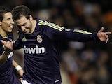 Real striker Gonzalo Higuain celebrates his goal against Valencia on January 20, 2013