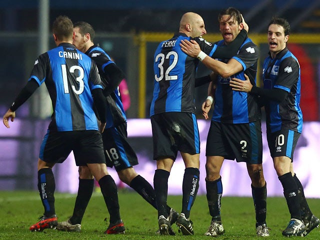 Atalanta's Guglielmo Stendardo is congratulated by team mates after scoring the equaliser against Cagliari on January 20, 2013
