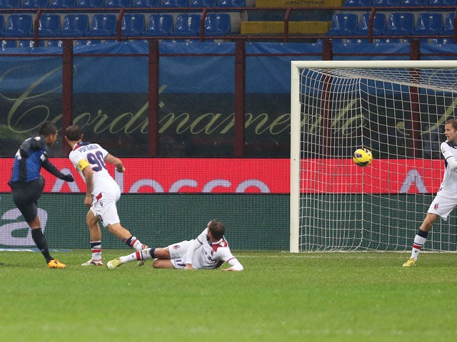 Inter Milan player Fredy Guarin scores during his sides Italian Cup quarter final against Bologna on January 15, 2013