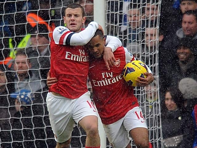 Jack Wilshere congratulates Theo Walcott after scoring against Chelsea on January 20, 2013