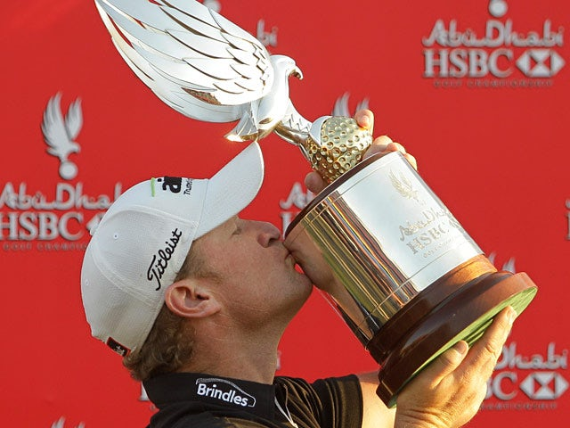 Welshman Jamie Donaldson kisses the trophy after winning the Abu Dhabi Golf Championship on January 20, 2013