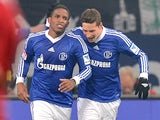 Schalke's Jefferson Farfan is congratulated by team mate Julian Draxler after scoring the opening goal against Hannover on January 18, 2013