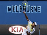 Jo-Wilfried Tsong serves during his second round win over Go Soeda on January 17, 2013