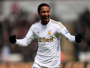 De Guzman delighted with Swansea extension