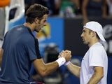 Juan Martin Del Potro shakes hands with Benjamin Becker following their second round match on January 17, 2013