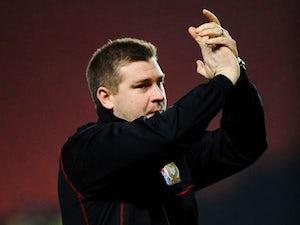 McLoughlin signs new MK Dons deal