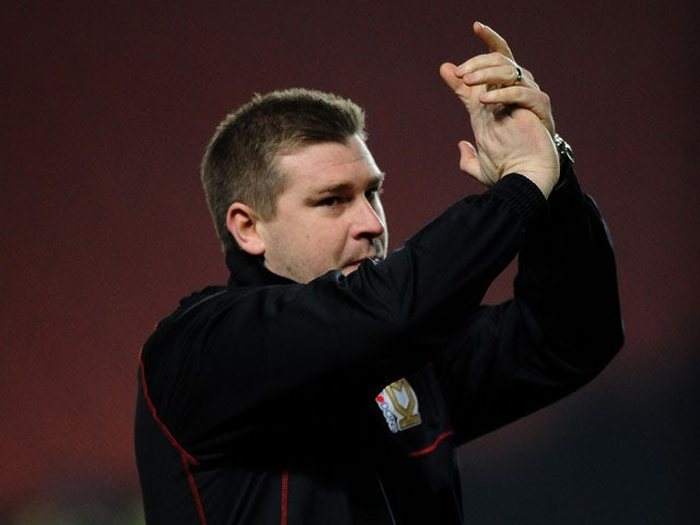 Manager of MK Dons Karl Robinson applauds the fans during his sides FA Cup match on January 15, 2013