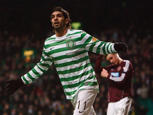 Celtic's Lassad Nouioui celebrates after scoring his team's fourth against Hearts on January 19, 2013