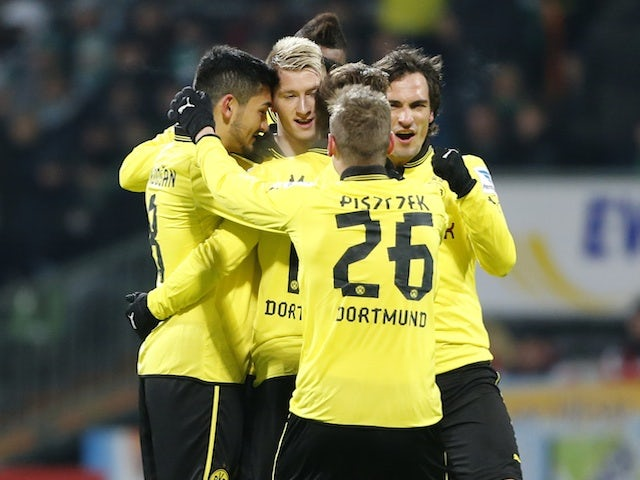 Dortmund players celebrate with Marco Reus following his goal against Werder Bremen on January 19, 2013