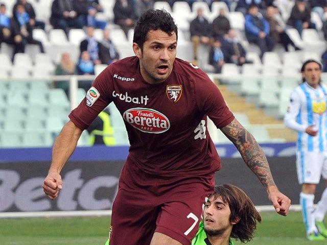 Torino's Mario Alberto Santana celebrates after scoring the opening goal against Pescara on January 20, 2013