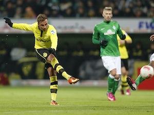 Dortmund cruise into last eight