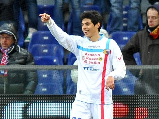Catania's Pablo Cesar Barrientos celebrates scoring his team's second against Genoa on January 20, 2013