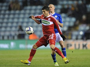 Leicester City's Paul Konchesky and Middlesbrough's Emmanuel Ledesma battle for the ball on January 18, 2013