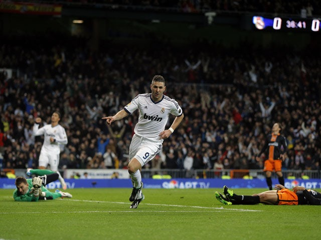 Karim Benzema celebrates scoring for Real Madrid in their Copa del Rey clash with Valencia on January 15, 2013
