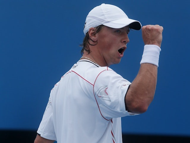 Lithuanian Ricardas Berankis celebrates his second round victory over Florian Mayer on January 17, 2013