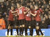 Man Utd players congratulate Robin Van Persie after opening the scoring against Tottenham on January 20, 2013