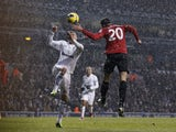 United forward RVP heads home the first goal against Tottenham on January 20, 2013