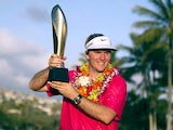 Russell Henley poses with the Sony Open trophy in Hawaii on January 13, 2013