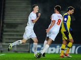 Shaun Williams celebrates scoring for MK Dons in their FA Cup third round replay on January 15, 2013