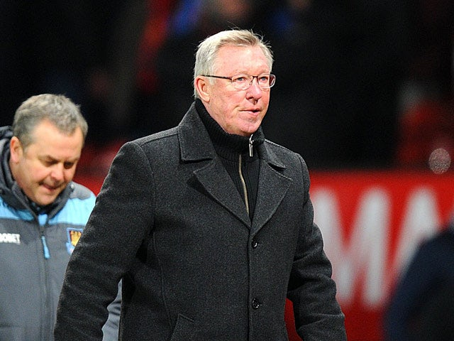 Manchester United boss Sir Alex Ferguson leaves the field at the final whistle after beating West Ham 1-0 during the FA Cup third round replay on January 16, 2013