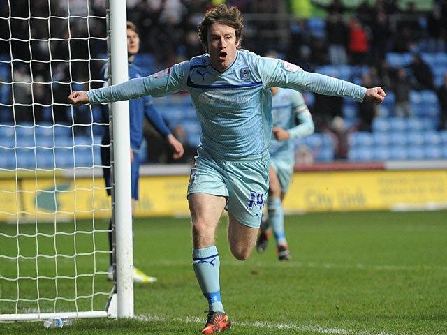 Coventry's Stephen Elliott celebrates scoring the opening goal against Oldham on January 19, 2013