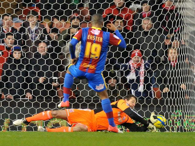 Stoke City goalkeeper Thomas Sorenseen saves a penalty for his side in their match with Crystal Palace on January 15, 2013