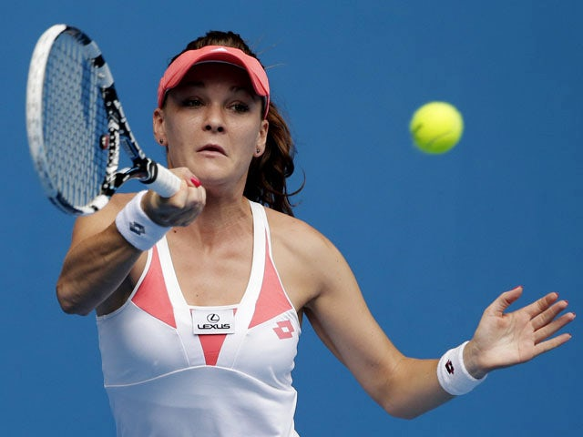 Poland's Agnieszka Radwanska playing a shot during her third round match at the Australian Open tennis championship on January 18, 2013