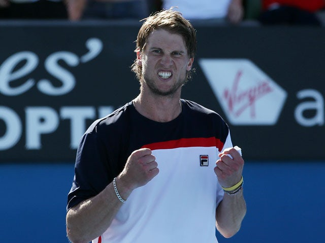 Italy's Andreas Seppi celebrates after winning his third round match at the Australian Open tennis championship on January 19, 2013