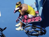 Germany's Angelique Kerber sit in her chair during her fourth round match against Ekaterina Makarova at the Australian Open tennis championship on January 20, 2013