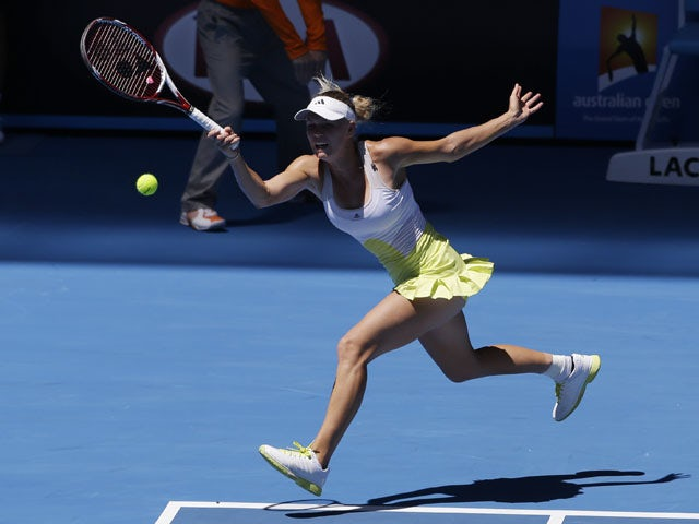 Caroline Wozniacki hits a forehand return in her first round match at the Australian Open tennis championship on January 15, 2013