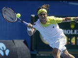 Spain's David Ferrer stretches for a return shot during his second round match with Tim Smyczek at the Australian Open tennis championship on January 16, 2013