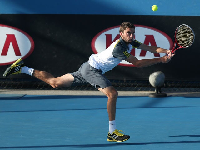 France's Gilles Simon hits a shot during his match with Filippo Volandri during the first round of the Australian Open tennis championship on January 15, 2013