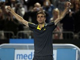 France's Gilles Simon celebrates after winning his third round match at the Australian Open tennis championship on January 20, 2013