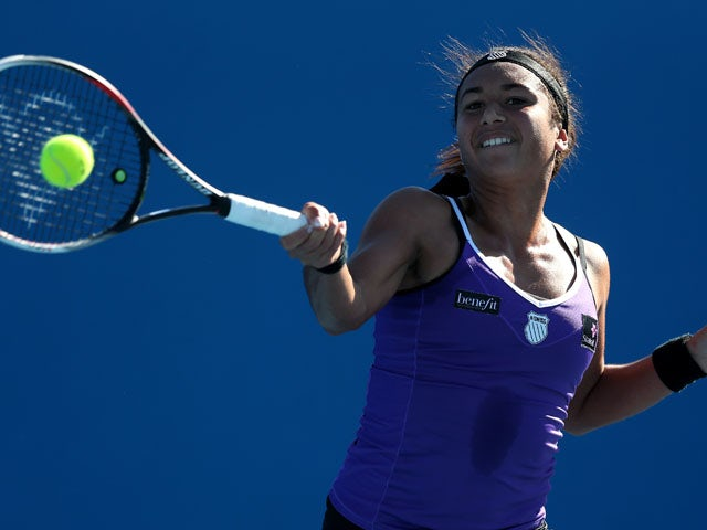 Heather Watson hits a forehand return shot during her first round match with Alexandra Cadantu at the Australian Open tennis championship on January 14, 2013
