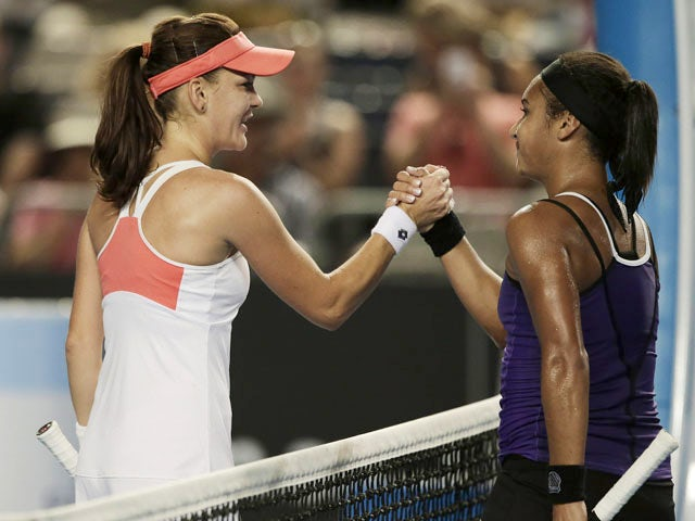 Heather Watson of Britain congratulates Poland's Agnieszka Radwanska after defeating her in the third round at the Australian Open tennis championship on January 18, 2013
