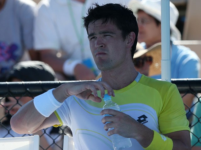 Britain's Jamie Baker during a break in play in his first round match at the Australian Open tennis championship on January 15, 2013