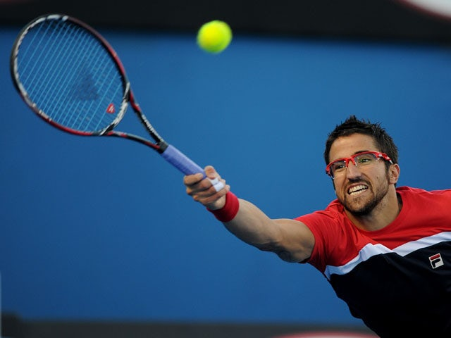 Serbia's Janko Tipsarevic stretches for the ball during his second round match at the  Australian Open tennis championship on January 16, 2013