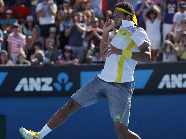 Frenchman Jo-Wilfried Tsonga leaps for joy after winning his third round match at the Australian Open tennis championship on January 19, 2013