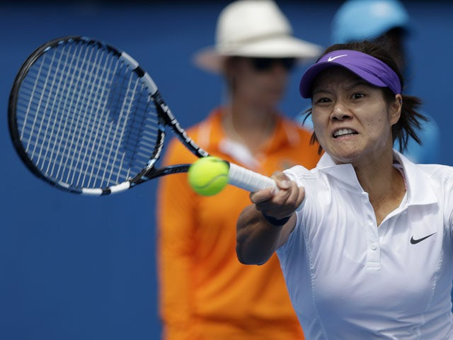 China's Li Na makes a forehand return during her first round match against Sesil Karatantcheva at the Australian Open tennis championship on January 14, 2013