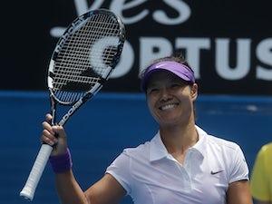 Li Na advances into fourth round