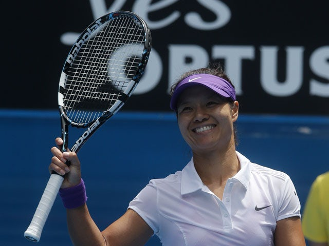China's Li Na celebrates after defeating Sorana Cirstea in the third round of the Australian Open tennis championship on January 18, 2013