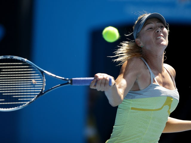Russia's Maria Sharapova hits a forehand return in her fourth round match at the Australian Open tennis championship on January 20, 2013