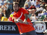 Marin Cilic of Croatia hits a return shot during his first round match with Marinko Matosevic at the Australian Open tennis championship on January 15, 2013