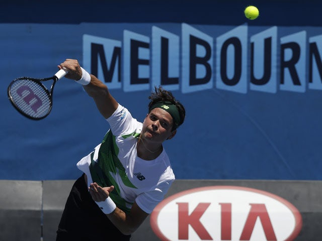 Milos Raonic of Canada serves to Jan Hajek in their first round match at  the Australian Open tennis championship on January 15, 2013