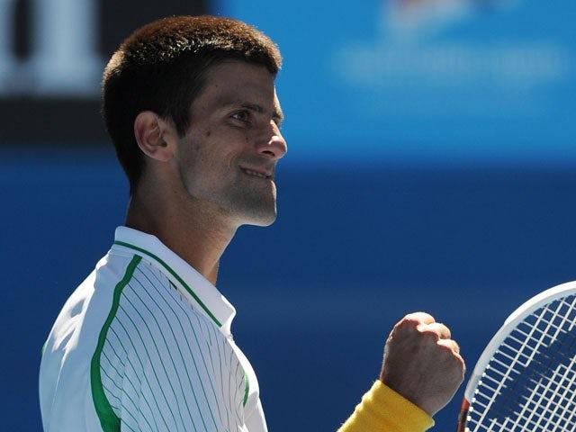 Novak Djokovic celebrates defeating Paul-Henri Mathieu at the Australian Open tennis championship on January 13, 2013