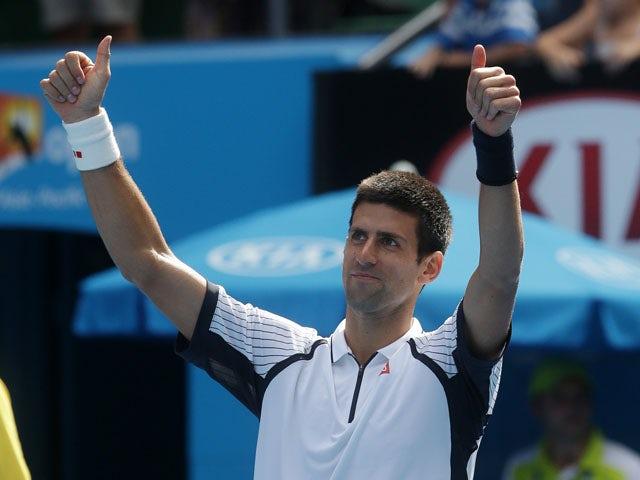 Novak Djokovic celebrates defeating Radek Stepanek in the third round at the Australian Open tennis championship on January 18, 2013